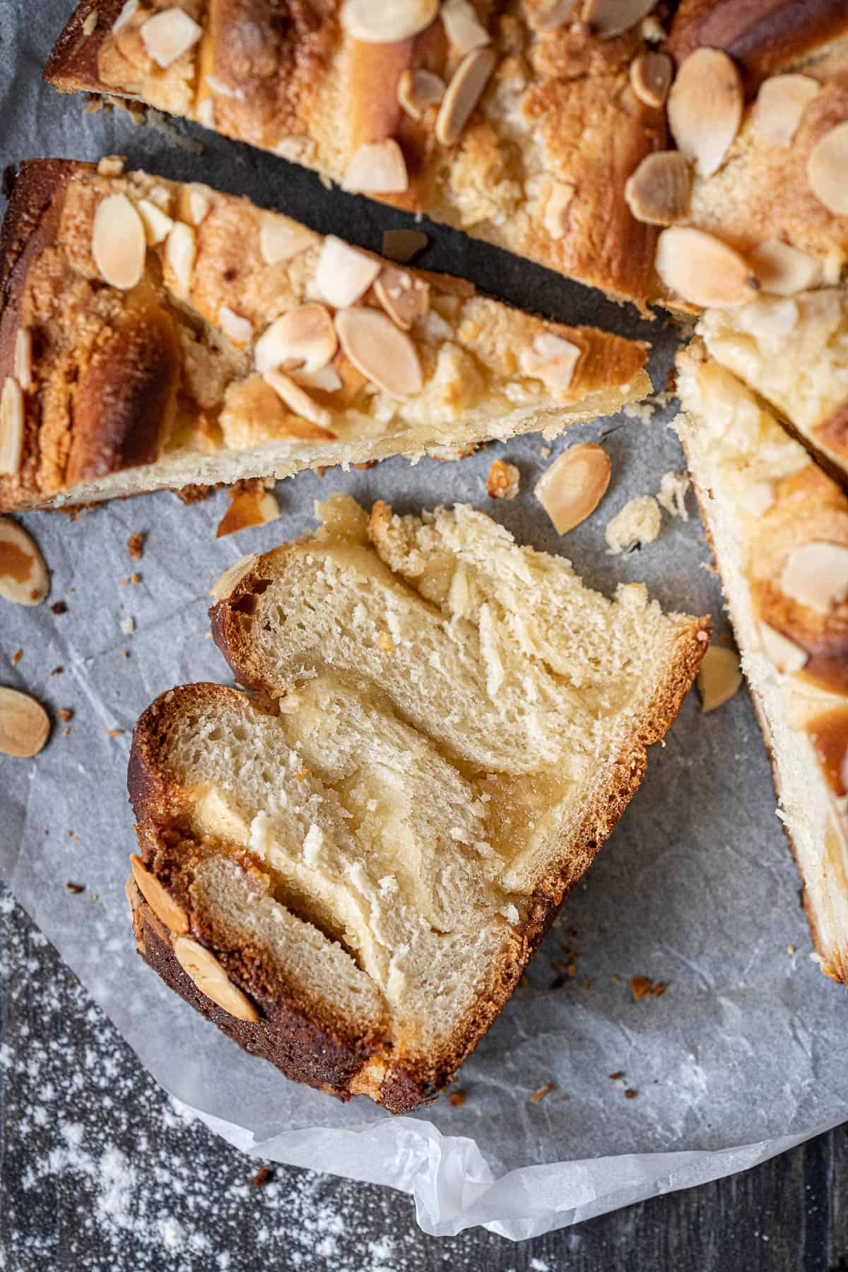 Close up of a slice of vegan almond bread twist.