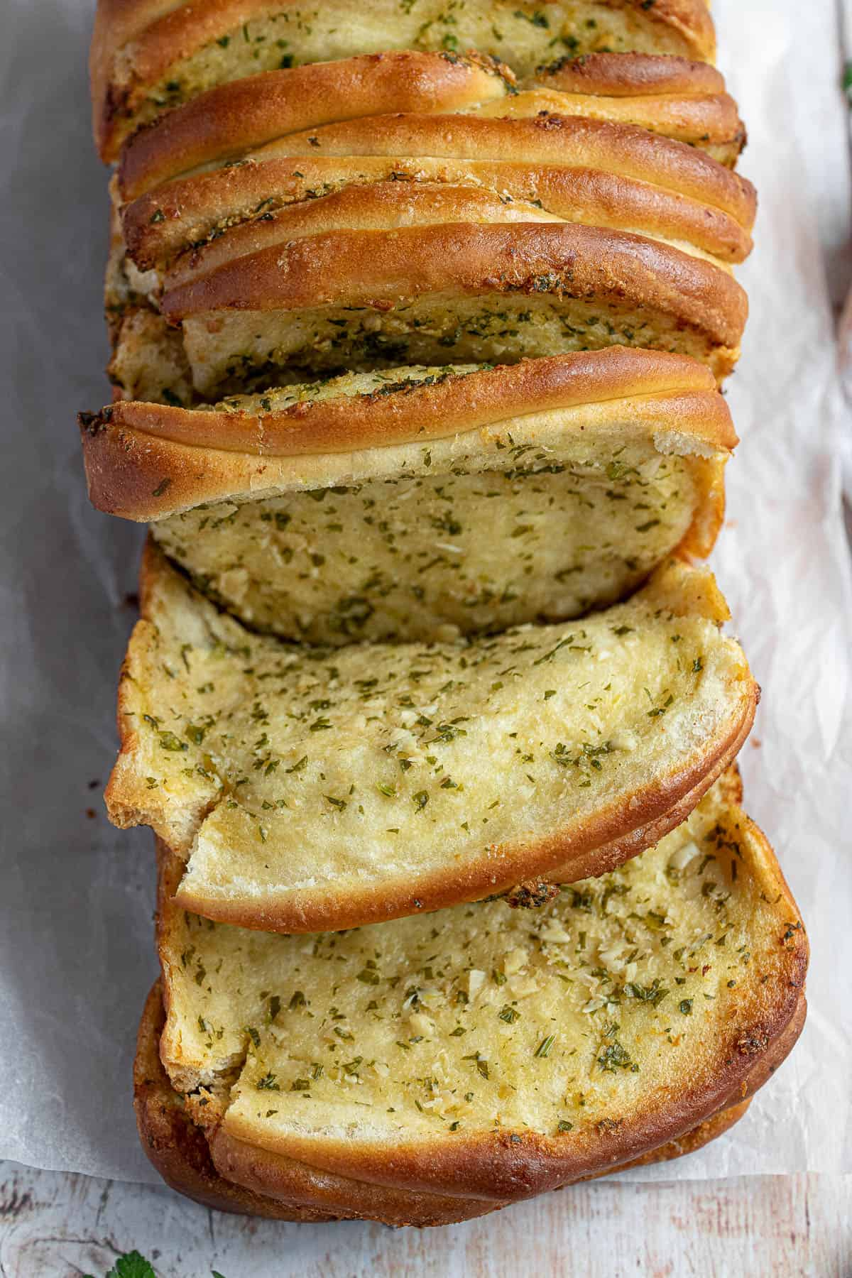 Close up of sections of vegan garlic pull apart bread.