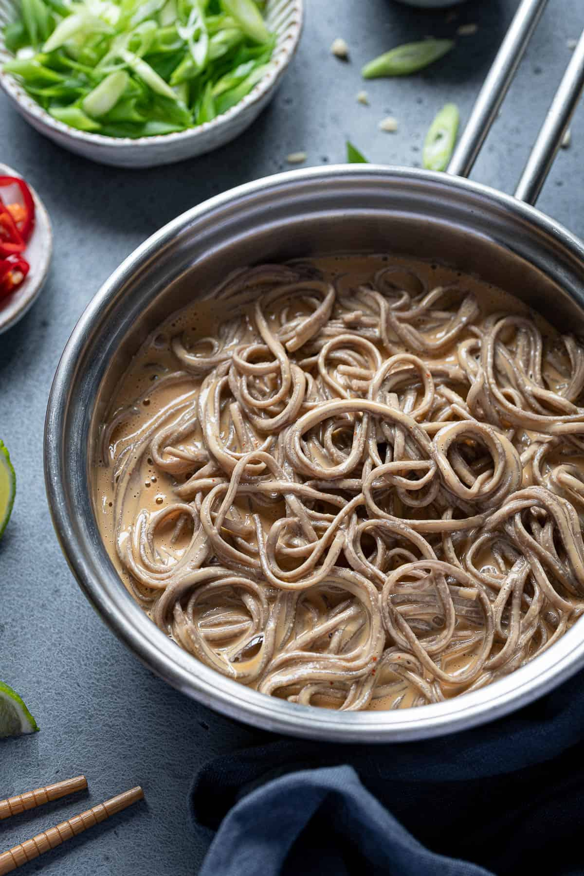 Close up of creamy peanut noodles in a pan.