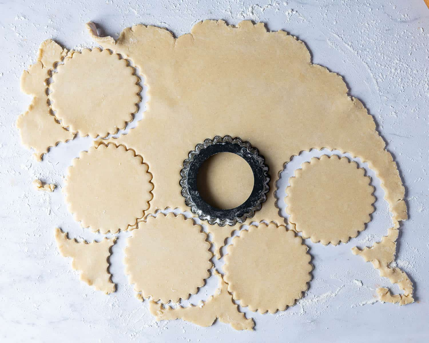 Step 2, the rolled out pastry with rounds being stamped out.