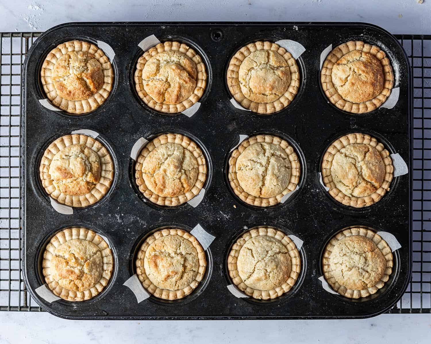The baked tarts in the muffin tin.
