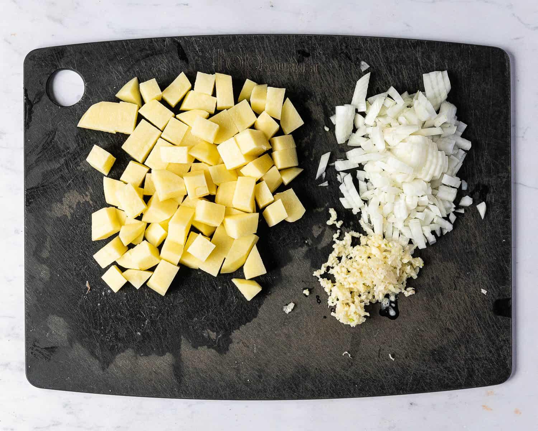 Step one, the prepared potato, onion and garlic.