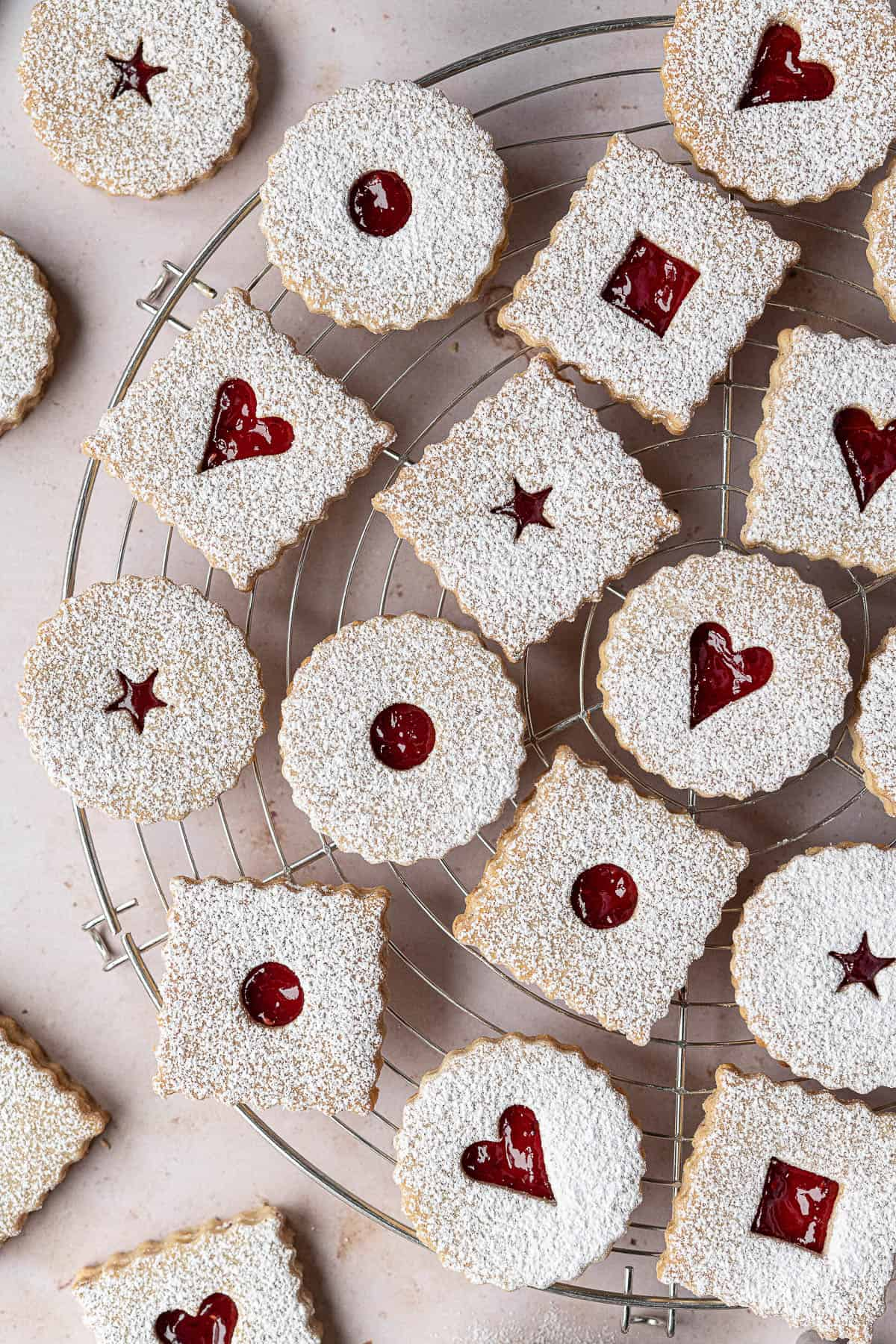Linzer cookies on a wire cooling rack.