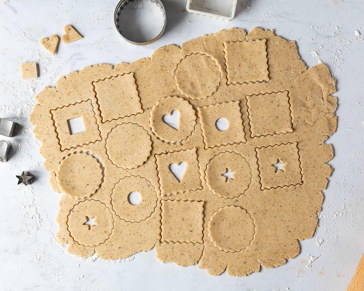 Step 3, rolling out the dough and cutting out the cookie shapes.