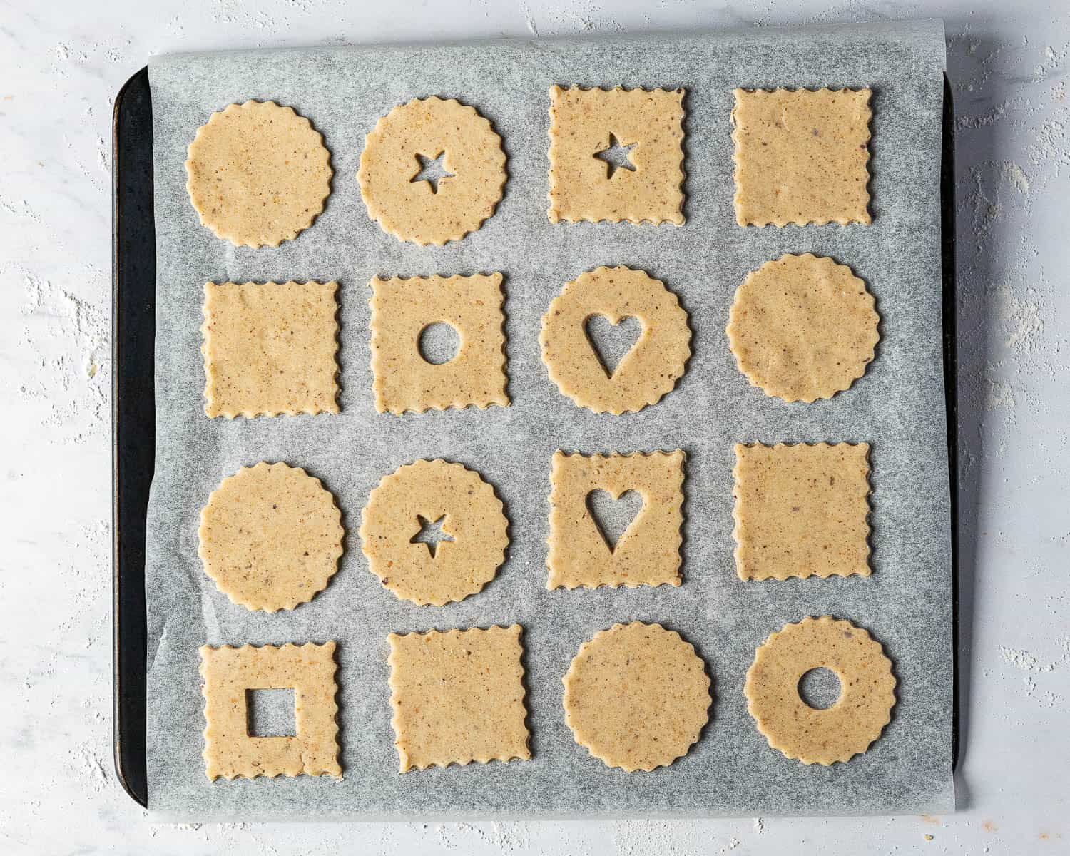 Step 4, the cookie cut outs on a baking sheet.