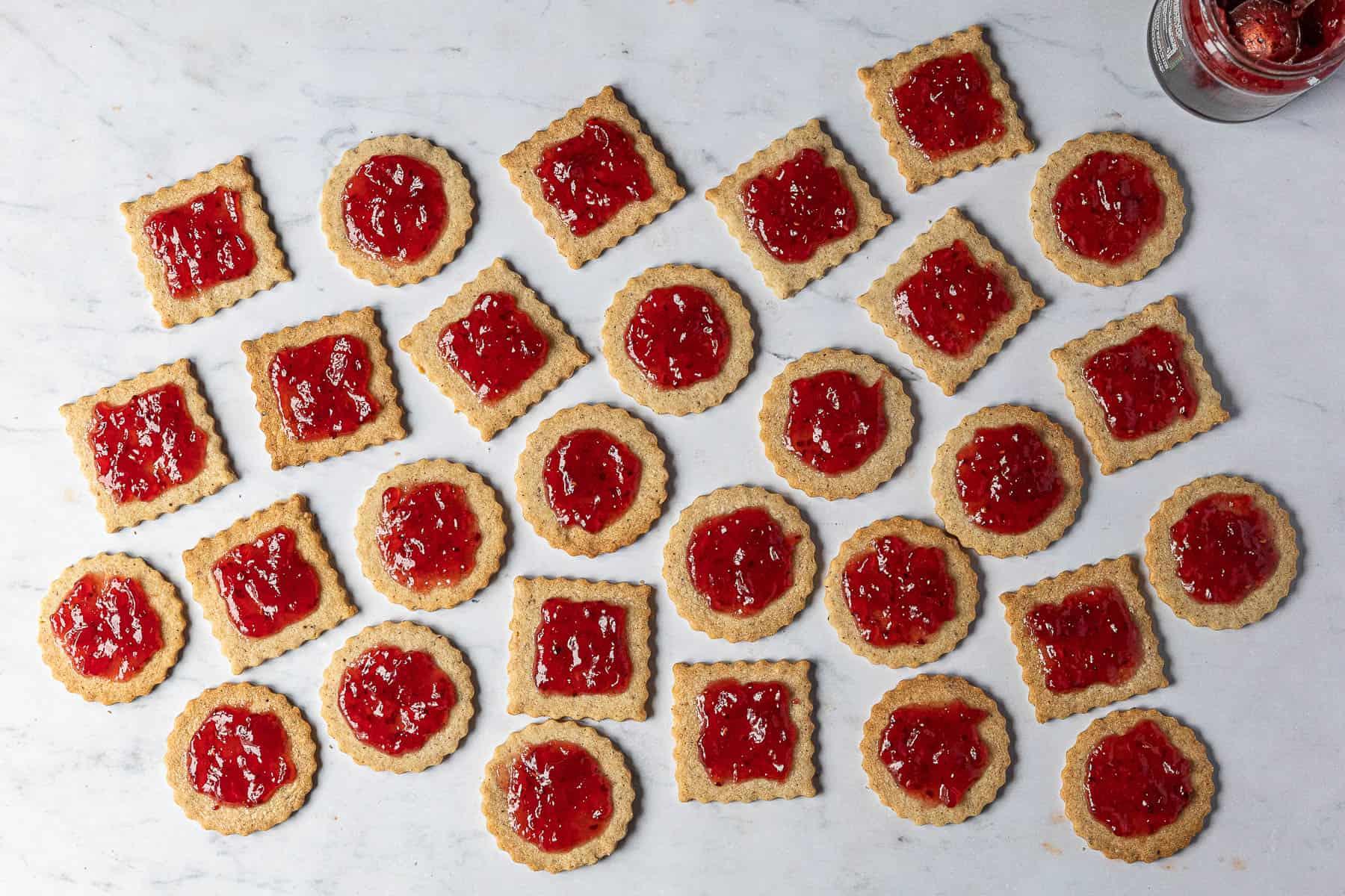 The jam coated bottom cookie halves.