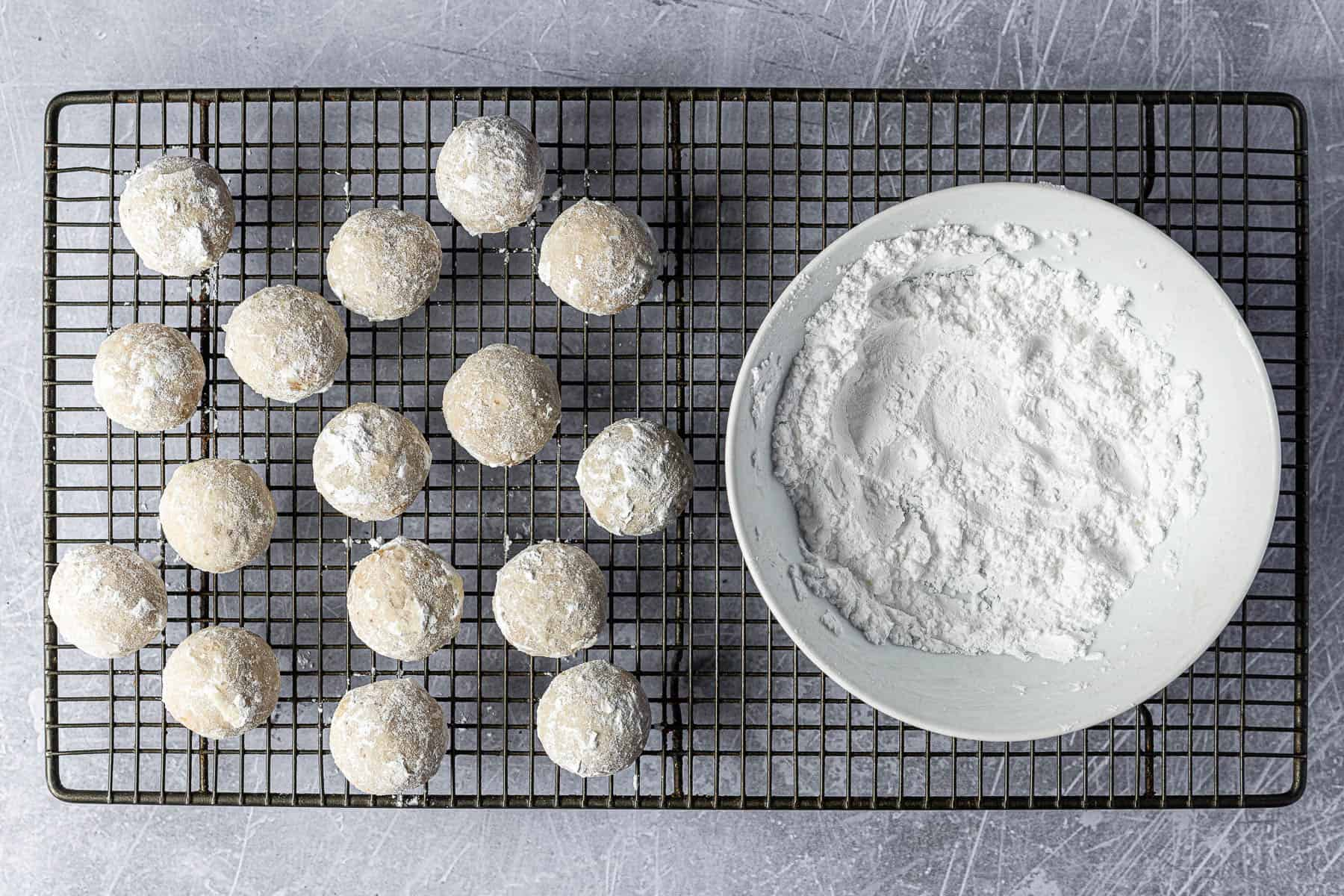 Step 7, rolling the cookies in powdered sugar.